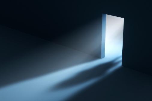 Shadow in open doorway